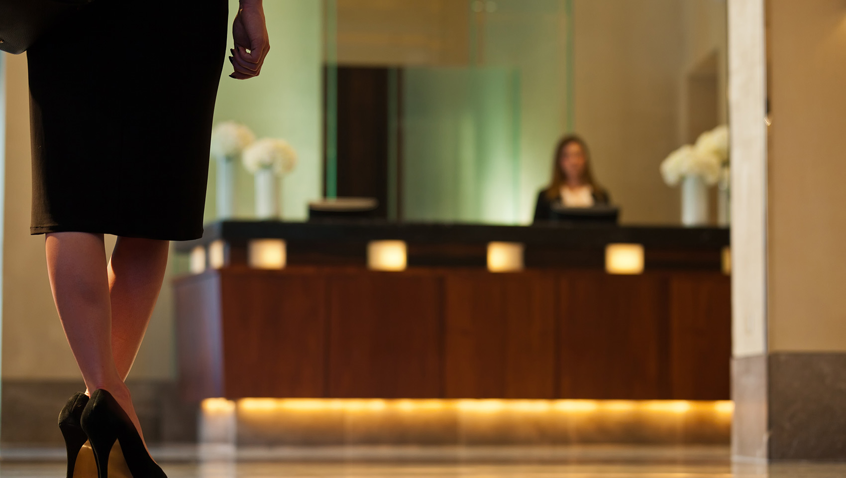 Business Woman at Kimpton Nine Zero Hotel Front Desk