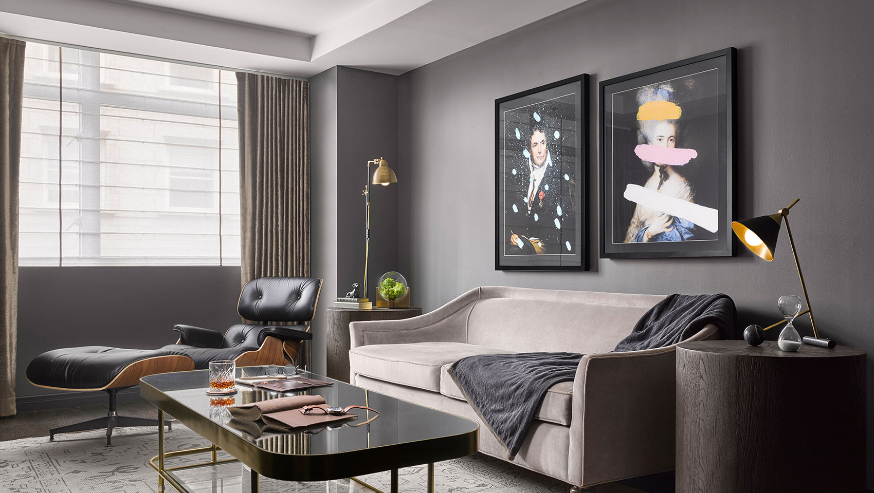 Kimpton Nine Zero Hotel Hub Suite Parlor with seating area and hanging art